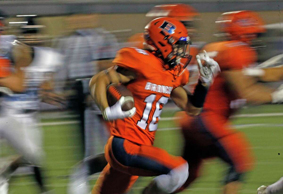 Brandeis running back Eduardo Webster runs for yardage in the third quarter. The Broncos took a 35-7 lead over Harlan before holding off the Hawks' fourth-quarter rally.