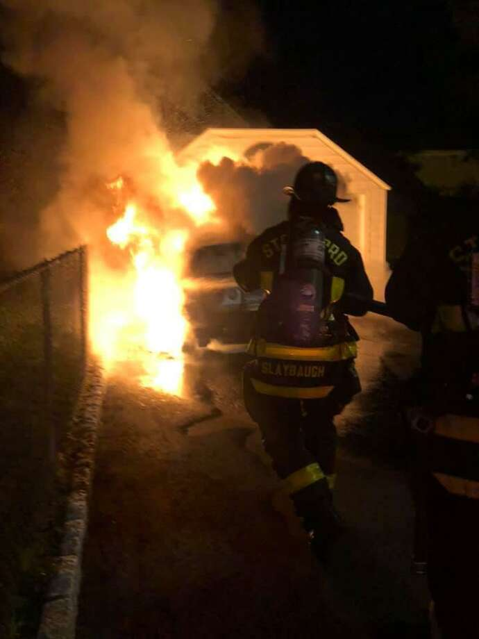 A car fire that spread to a garage on College Street was doused by Stratford firefighters shortly after midnight Sunday, Oct. 4, 2020. Photo: Stratford Professional Firefighters / Contributed Photo / Connecticut Post