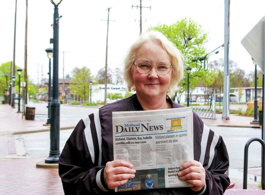 Lisa Bauder and her family have delivered newspapers for the Midland Daily News for almost a quarter of a century. While the walking routes switched to mail at the end of March, Bauder still delivers to vendors. (Photo by Niky House)