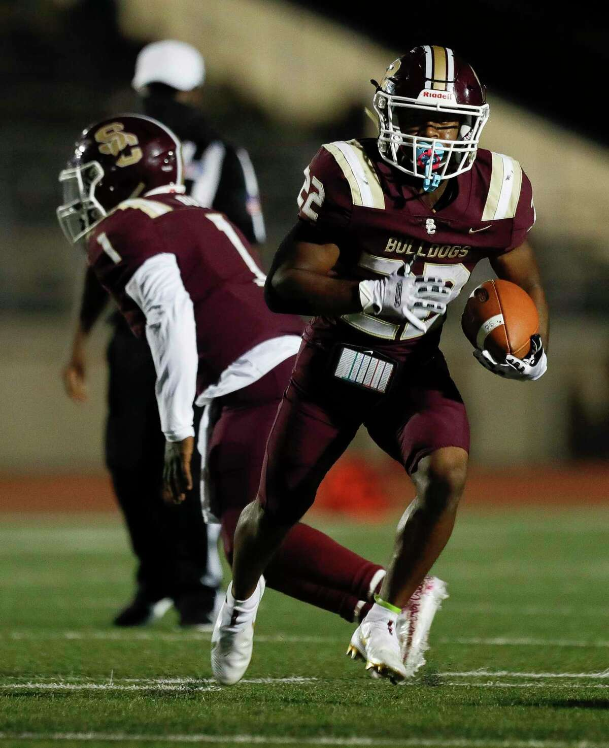 Summer Creek running back Torrie Curry (22) runs the ball during the first quarter of a non-district high school football game at Turner Stadium, Saturday, Oct. 3 in Humble.