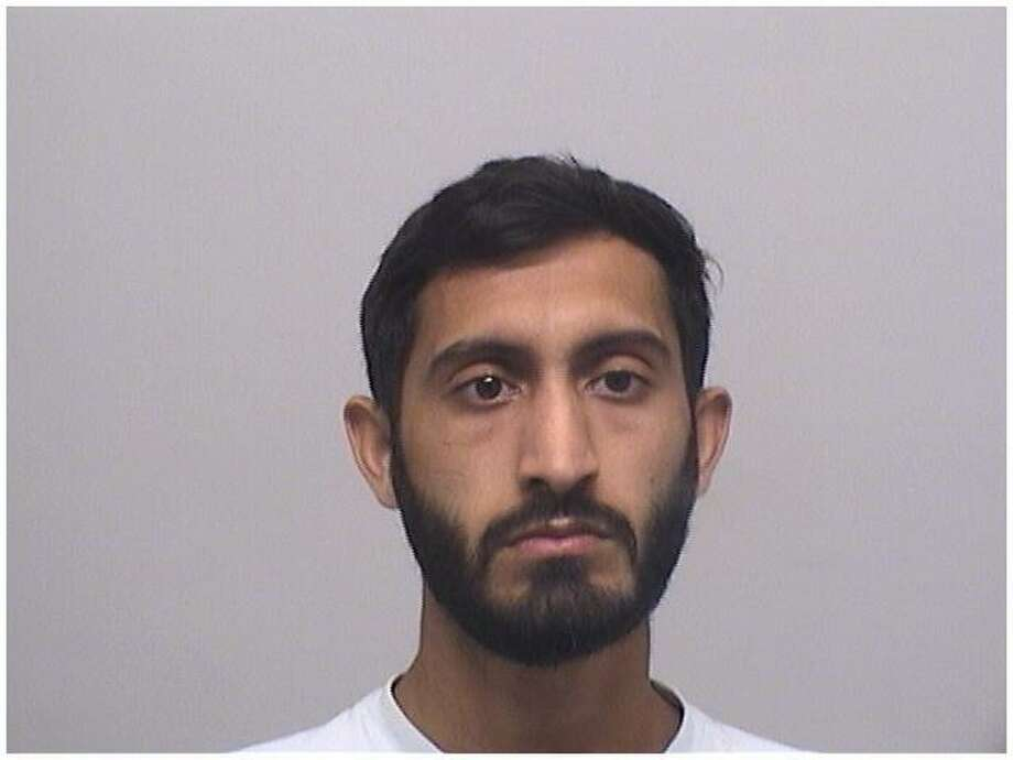 Sarmad Hussain, 22, of Stamford, was arraigned on charges of drunk driving, reckless driving and three counts of second-degree assault with a motor vehicle after striking three people in a front yard on Hope Street in June. Photo: Stamford Police Department / Contributed