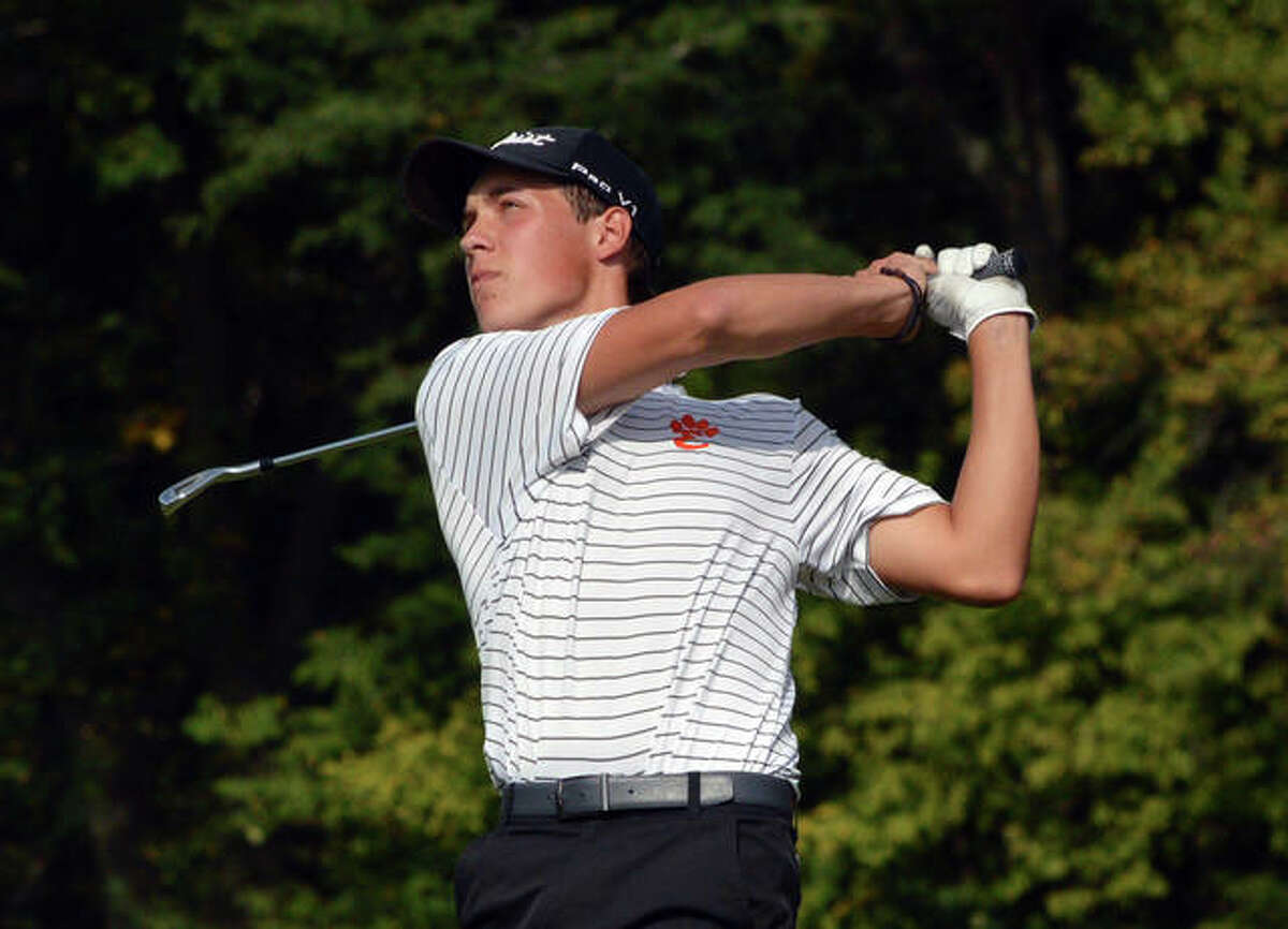 Edwardsville's Tyler Janson watches the flight of the ball after hitting a tee shot on hole No. 13 at Oak Brook Golf Club during a Sept. 22 dual match against Triad.
