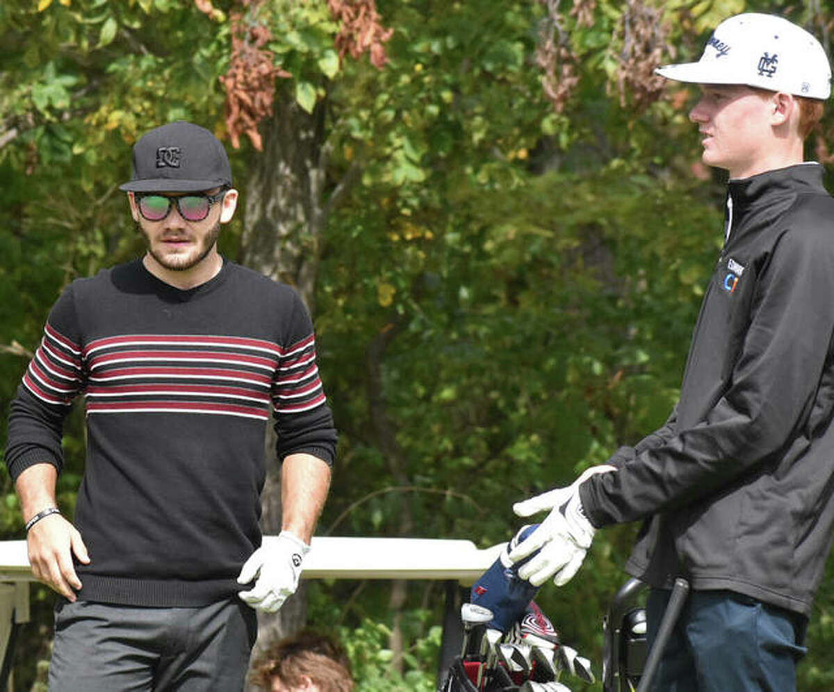 Metro-East Lutheran's Antonio Ybarra, left, and Father McGivney's Drew Sowerwine wait to tee off on No. 13 at Timber Lakes Golf Course on Friday during the Prairie State Conference Tournament.