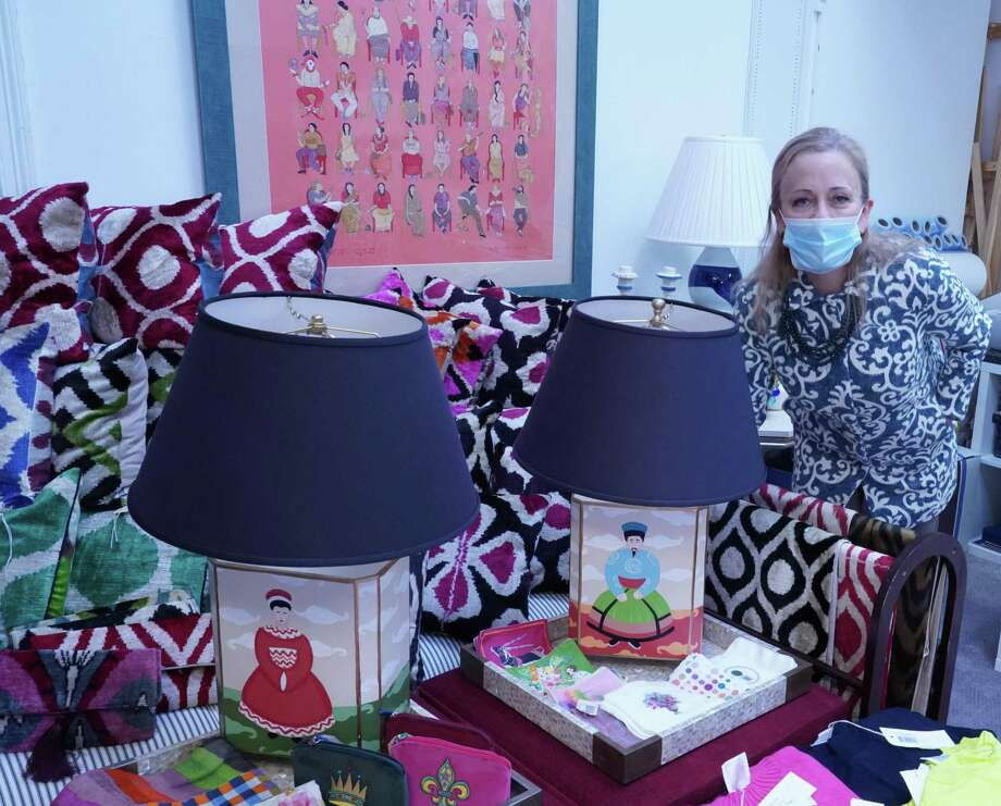 Laura Mason, owner of Sitting Pretty, has just opened a new store on the second floor at 111 Elm St. in New Canaan with a wide range of items such as lamps, throw pillows, gifts, and tableware from more than seven countries. Photo: Grace Duffield / Hearst Connecticut Media