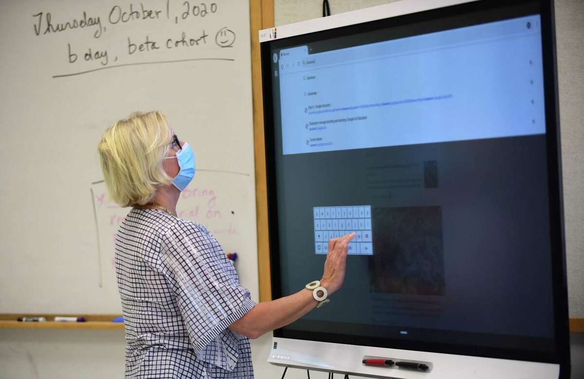 Teacher Paula Fortuna sets up her technology in the classroom at the Center for Global Studies Friday, October 2, 2020, at Brien McMahon High School in Norwalk, Conn.
