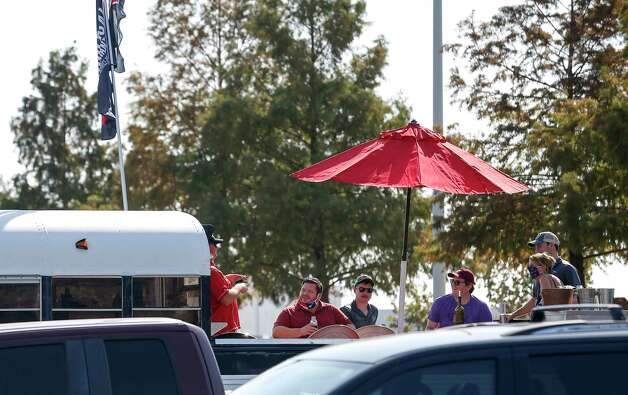 Fans hang out in a parking lot before an NFL game between the Houston Texans and the Minnesota Vikings on Sunday, Oct. 4 2020, at NRG Stadium in Houston. Photo: Jon Shapley, Staff Photographer / © 2020 Houston Chronicle