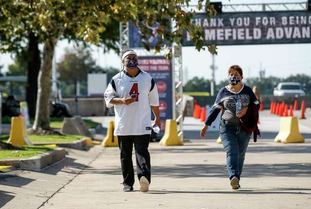 Jose Banda, left, and his mom Cecilia Banda arrive before an NFL game between the Houston Texans and the Minnesota Vikings on Sunday, Oct. 4 2020, at NRG Stadium in Houston. Photo: Jon Shapley, Staff Photographer / © 2020 Houston Chronicle