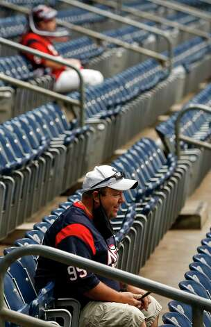 A fan who is not wearing his mask properly waits for the start of an NFL game between the Houston Texans and the Minnesota Vikings on Sunday, Oct. 4 2020, at NRG Stadium in Houston. Photo: Jon Shapley, Staff Photographer / © 2020 Houston Chronicle