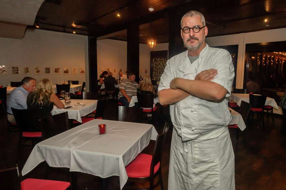 Rafael Ruiz, head chef and owner of Finch Hutton Beaumont stands in the main dining room during a Saturday preview dinner before the official opening of the new restaurant. Photo made on September 26, 2020.  Fran Ruchalski/The Enterprise Photo: Fran Ruchalski / Fran Ruchalski / Staff Photographer / © 2020 The Beaumont Enterprise