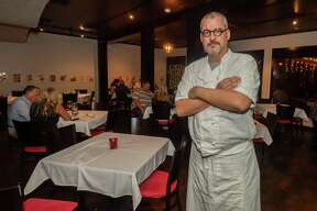 Rafael Ruiz, head chef and owner of Finch Hutton Beaumont stands in the main dining room during a Saturday preview dinner before the official opening of the new restaurant. Photo made on September 26, 2020. Fran Ruchalski/The Enterprise