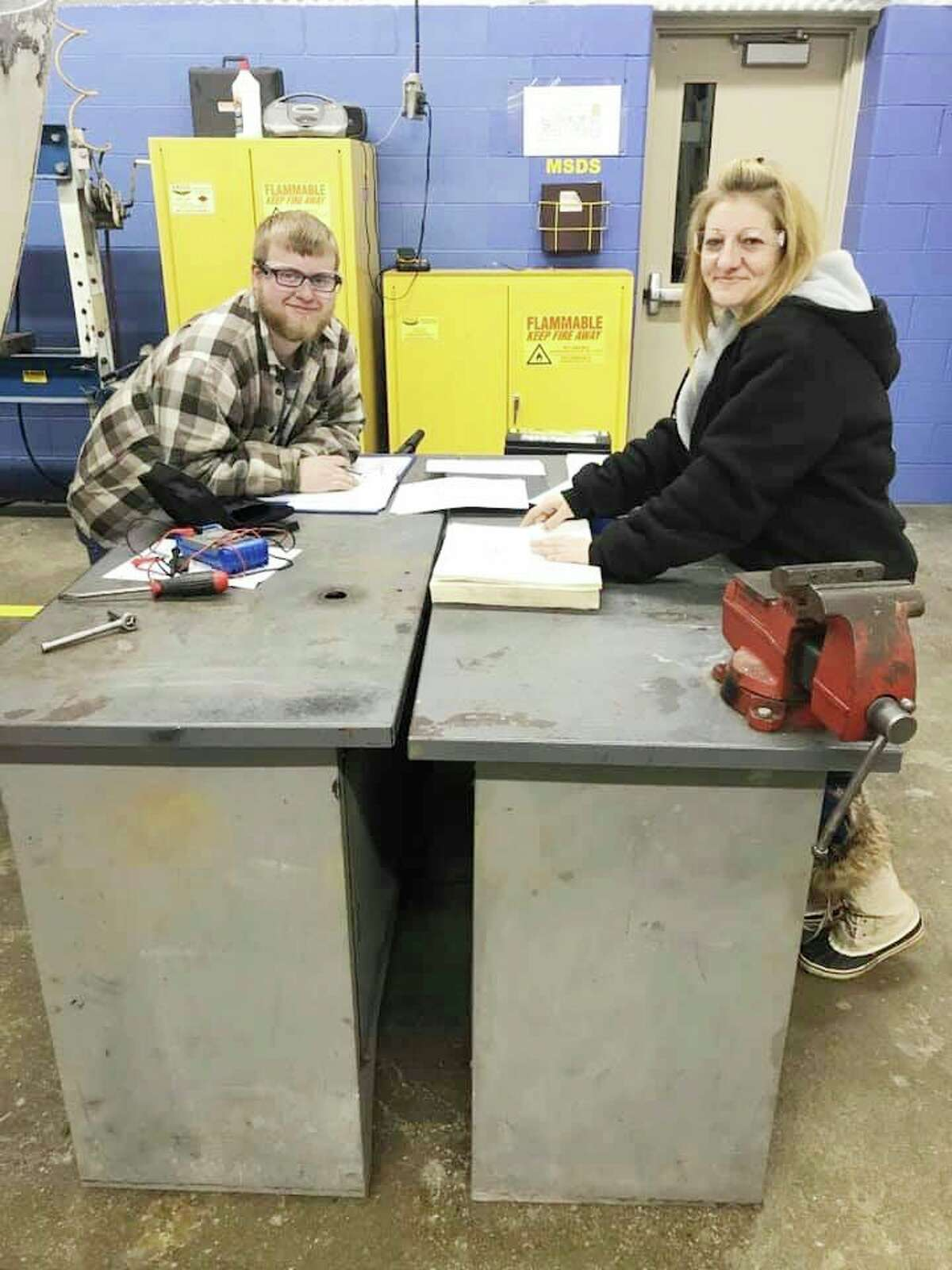 Two auto students work to complete a project in this photo taken prior to the COVID-19 pandemic. Currently, the Meceola Tech Centeris having a more difficult time than usual finding students to enroll due to concerns about COVID-19. (Courtesy photo)