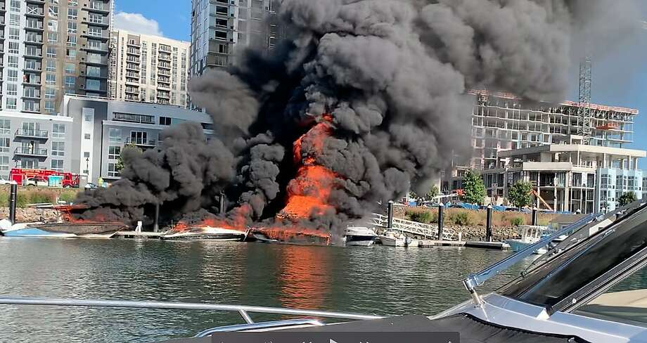 Peter Adler of Darien captured this image of flames consuming boats, a tiki bar and a dock in Stamford Saturday afternoon, Oct. 3. Photo: Peter Adler, Contributed Photo