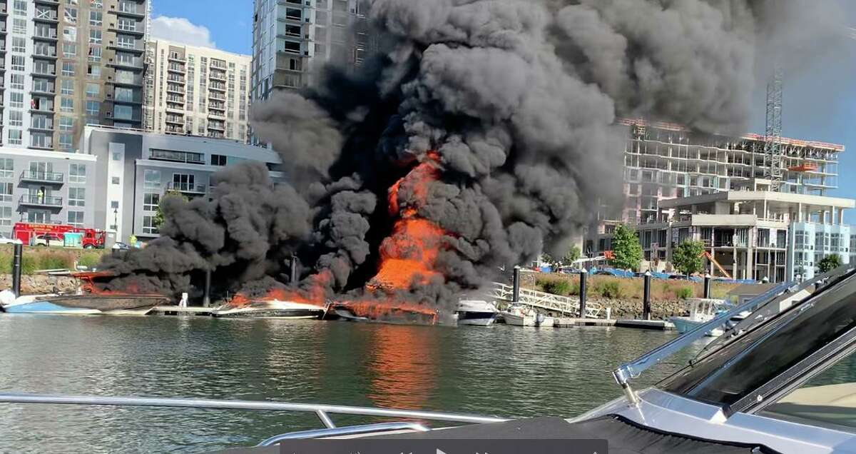 Peter Adler of Darien captured this image of flames consuming boats, a tiki bar and a dock in Stamford Saturday afternoon, Oct. 3, 2020.