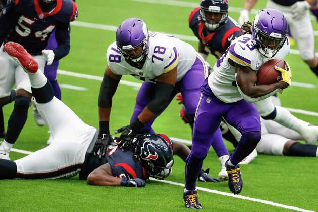 Minnesota Vikings running back Dalvin Cook (33) breaks away from the Houston Texans defense on his way to a 7-yard touchdown run during the first half of an NFL football game at NRG Stadium on Sunday, Oct. 4, 2020, in Houston. Photo: Brett Coomer, Staff Photographer / © 2020 Houston Chronicle