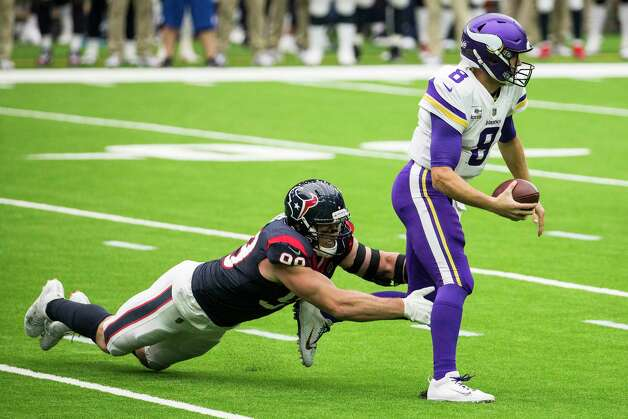 Houston Texans defensive end J.J. Watt (99) catches Minnesota Vikings quarterback Kirk Cousins (8) from behind as he scrambles out of the pocket for a 2-yard gain during the first half of an NFL football game at NRG Stadium on Sunday, Oct. 4, 2020, in Houston. Photo: Brett Coomer, Staff Photographer / © 2020 Houston Chronicle
