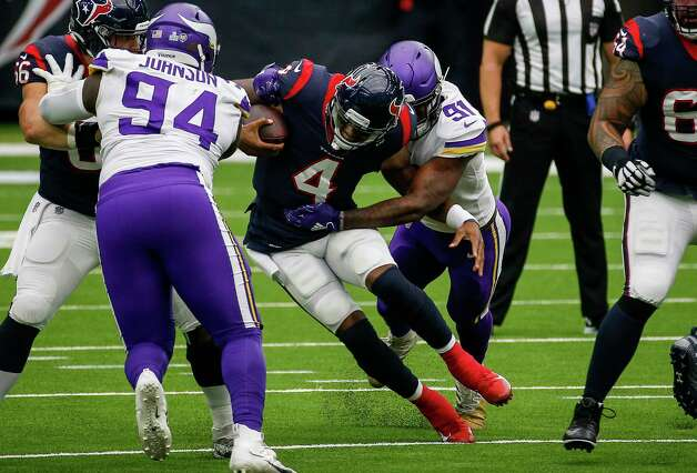 Houston Texans quarterback Deshaun Watson (4) gets away from defensive end Yannick Ngakoue (91) while scrambling during the first quarter of an NFL game on Sunday, Oct. 4 2020, at NRG Stadium in Houston. Photo: Jon Shapley, Staff Photographer / © 2020 Houston Chronicle