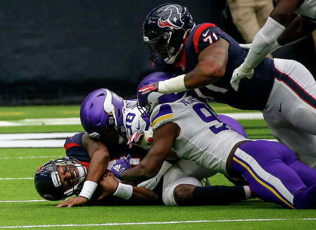 Houston Texans quarterback Deshaun Watson (4) is sacked by Minnesota Vikings defensive end D.J. Wonnum (98) and defensive end Yannick Ngakoue (98) during the first quarter of an NFL game on Sunday, Oct. 4 2020, at NRG Stadium in Houston. Photo: Jon Shapley, Staff Photographer / © 2020 Houston Chronicle
