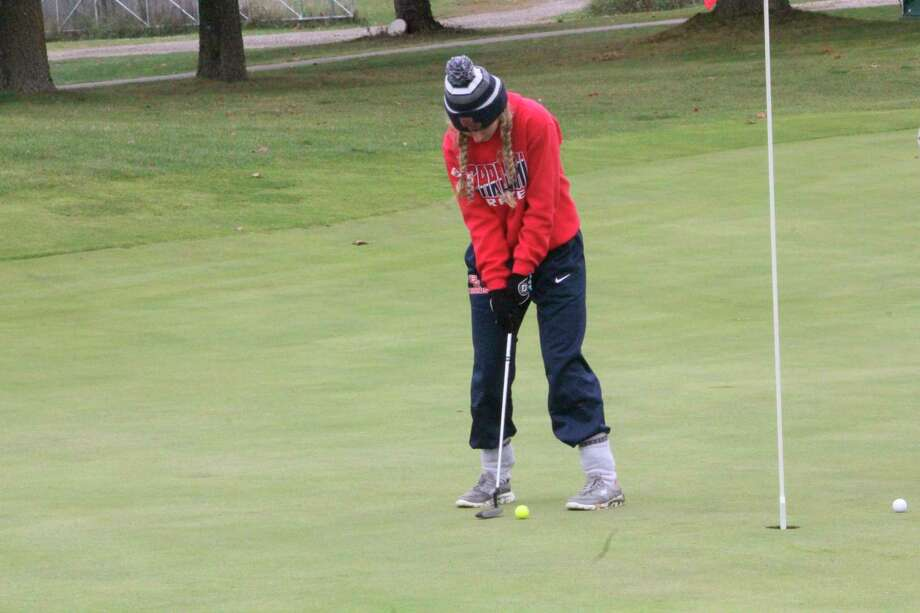 Big Rapids' Ally Sims watches her putt during the Katke Classic on Saturday. (Pioneer photo/John Raffel)