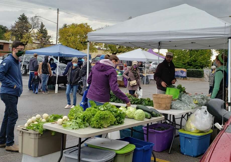 The Manistee Farmers Market adopted a list of protocol aimed at preventing the spread of COVID-19, like a hand-washing station and requisite masks within the market. Photo: Arielle Breen/News Advocate