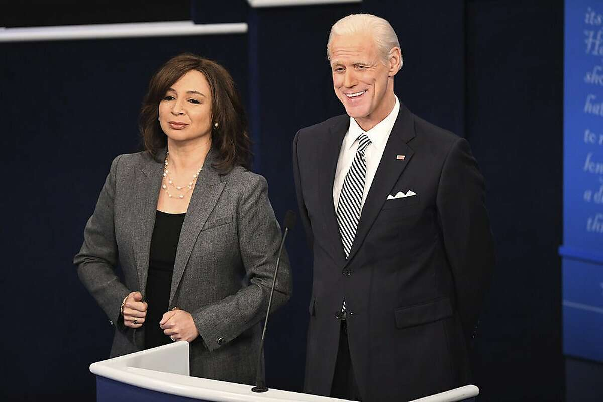 This image released by NBC shows Maya Rudolph as Kamala Harris, left, and Jim Carrey as Joe Biden during the