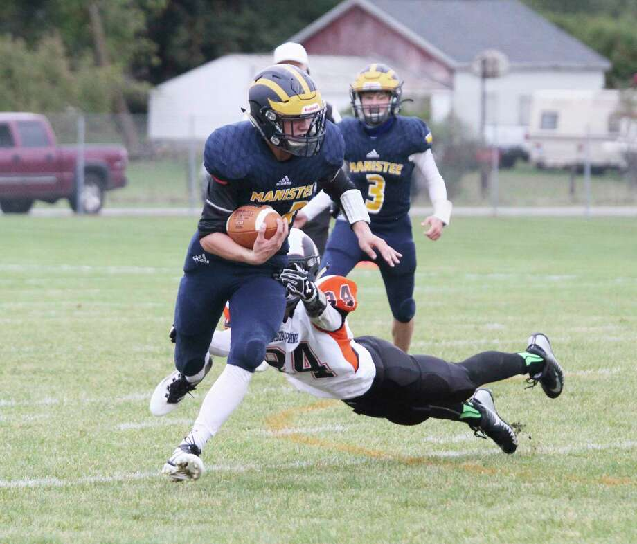 Manistee's Joey Kott sheds a Harbor Springs tackler on Saturday during the Chippewas victory at home. (Dylan Savela/News Advocate)