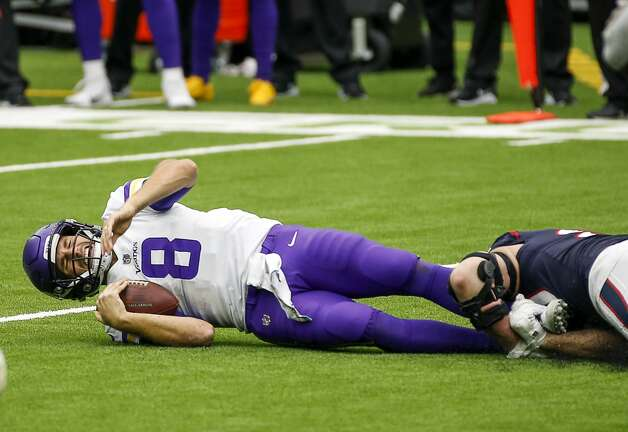 Minnesota Vikings quarterback Kirk Cousins (8) is sacked by Houston Texans defensive end J.J. Watt (99) during the first quarter of an NFL game on Sunday, Oct. 4 2020, at NRG Stadium in Houston. Photo: Jon Shapley/Staff Photographer / © 2020 Houston Chronicle