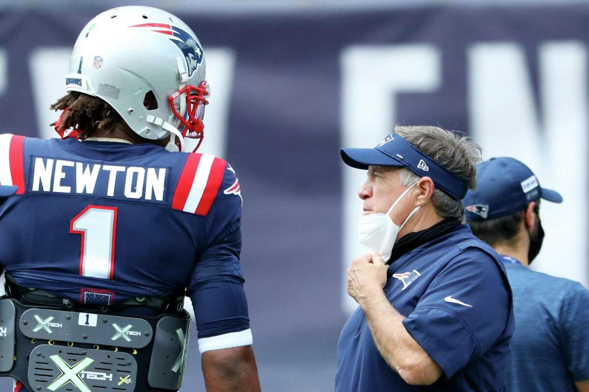 Patriots coach Bill Belichick, right, talks with quarterback Cam Newton before a game earlier this season.