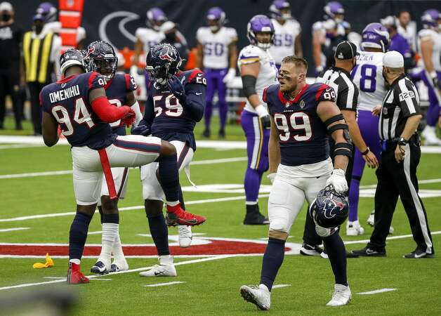 Houston Texans outside linebacker Whitney Mercilus (59), linebacker Jake Martin (54) and defensive end Charles Omenihu (94) celebrate after a sack by outside linebacker Whitney Mercilus (59) during the first quarter of an NFL game on Sunday, Oct. 4 2020, at NRG Stadium in Houston. Photo: Jon Shapley/Staff Photographer / © 2020 Houston Chronicle