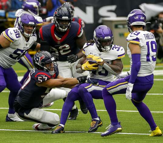 Minnesota Vikings running back Dalvin Cook (33) breaks a tackle by Houston Texans outside linebacker Brennan Scarlett (57) during the second quarter of an NFL game on Sunday, Oct. 4 2020, at NRG Stadium in Houston. Photo: Jon Shapley/Staff Photographer / © 2020 Houston Chronicle