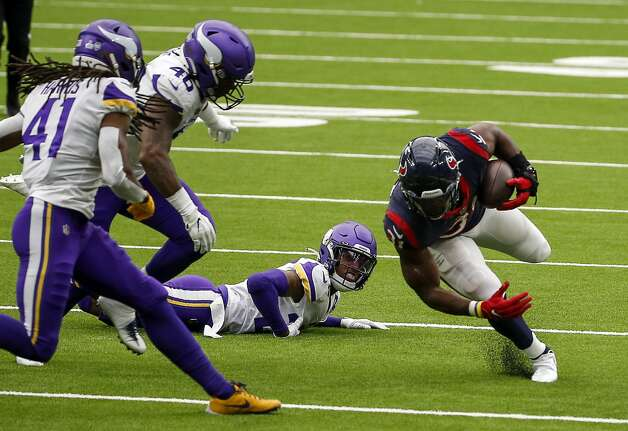 Minnesota Vikings cornerback Cameron Dantzler (27) watches as Houston Texans running back David Johnson (31) runs downfield during the fourth quarter of an NFL game on Sunday, Oct. 4 2020, at NRG Stadium in Houston. Photo: Jon Shapley/Staff Photographer / © 2020 Houston Chronicle