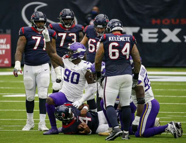 Minnesota Vikings defensive end Jalyn Holmes (90) reacts after tackling Houston Texans quarterback Deshaun Watson (4) during the fourth quarter of an NFL game on Sunday, Oct. 4 2020, at NRG Stadium in Houston. Photo: Jon Shapley/Staff Photographer / © 2020 Houston Chronicle