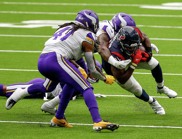 Houston Texans running back David Johnson (31) gets tackled by Minnesota Vikings linebacker Todd Davis (40) and free safety Anthony Harris (41) during the fourth quarter of an NFL game on Sunday, Oct. 4 2020, at NRG Stadium in Houston. Photo: Jon Shapley/Staff Photographer / © 2020 Houston Chronicle