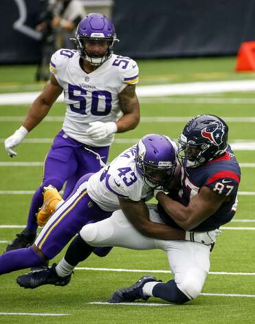 Houston Texans tight end Darren Fells (87) is tackled by Minnesota Vikings strong safety George Iloka (43) during the fourth quarter of an NFL game on Sunday, Oct. 4 2020, at NRG Stadium in Houston. Photo: Jon Shapley/Staff Photographer / © 2020 Houston Chronicle