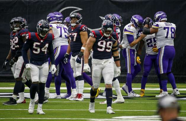 Houston Texans outside linebacker Brennan Scarlett (57) reacts as Minnesota Vikings running back Alexander Mattison (25) celebrates with teammates quarterback Kirk Cousins (8) and offensive guard Dakota Dozier (78) after he scored a touchdown during the fourth quarter of an NFL game on Sunday, Oct. 4 2020, at NRG Stadium in Houston. Photo: Jon Shapley/Staff Photographer / © 2020 Houston Chronicle