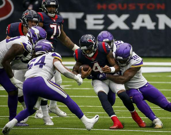 Houston Texans quarterback Deshaun Watson (4) gets tackled by Minnesota Vikings defensive end Jalyn Holmes (90) and defensive end Ifeadi Odenigbo (95) during the fourth quarter of an NFL game on Sunday, Oct. 4 2020, at NRG Stadium in Houston. Photo: Jon Shapley/Staff Photographer / © 2020 Houston Chronicle