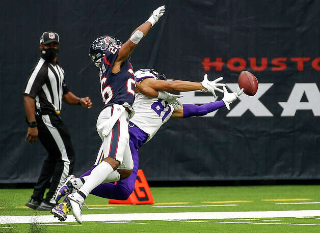 Minnesota Vikings wide receiver Bisi Johnson (81) misses a reception while defended by Houston Texans' Vernon Hargreaves III (26) during the second quarter of an NFL game on Sunday, Oct. 4 2020, at NRG Stadium in Houston. Photo: Jon Shapley/Staff Photographer / © 2020 Houston Chronicle