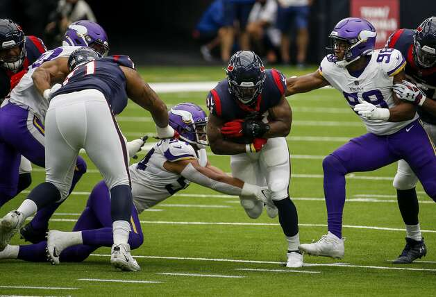 Houston Texans running back David Johnson (31) gets past Minnesota Vikings middle linebacker Eric Kendricks (54) and defensive end D.J. Wonnum (98) during the second quarter of an NFL game on Sunday, Oct. 4 2020, at NRG Stadium in Houston. Photo: Jon Shapley/Staff Photographer / © 2020 Houston Chronicle