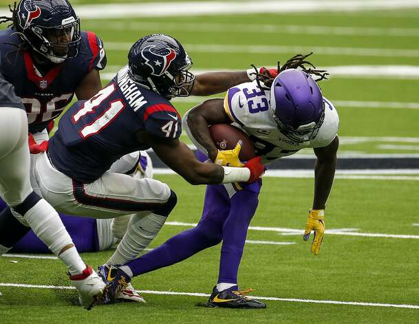 Houston Texans inside linebacker Zach Cunningham (41) tries to tackle Minnesota Vikings running back Dalvin Cook (33) during the second quarter of an NFL game on Sunday, Oct. 4 2020, at NRG Stadium in Houston. Photo: Jon Shapley/Staff Photographer / © 2020 Houston Chronicle