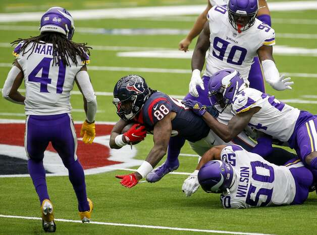 Houston Texans tight end Jordan Akins (88) is tackled by Minnesota Vikings outside linebacker Eric Wilson (50) and during the second quarter of an NFL game on Sunday, Oct. 4 2020, at NRG Stadium in Houston. Photo: Jon Shapley/Staff Photographer / © 2020 Houston Chronicle