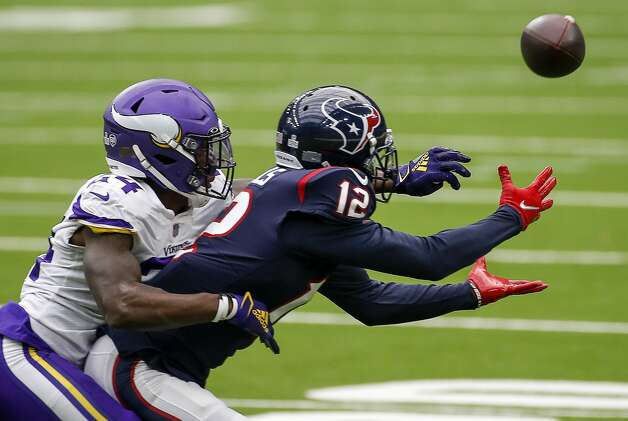 Houston Texans wide receiver Kenny Stills (12) misses a reception while defended by Minnesota Vikings defensive back Holton Hill (24) during the second quarter of an NFL game on Sunday, Oct. 4 2020, at NRG Stadium in Houston. Photo: Jon Shapley/Staff Photographer / © 2020 Houston Chronicle