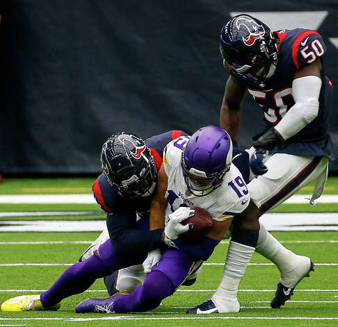 Minnesota Vikings wide receiver Adam Thielen (19) is tackled by Houston Texans linebacker Jake Martin (54) with help from linebacker Tyrell Adams (50) during the second quarter of an NFL game on Sunday, Oct. 4 2020, at NRG Stadium in Houston. Photo: Jon Shapley/Staff Photographer / © 2020 Houston Chronicle
