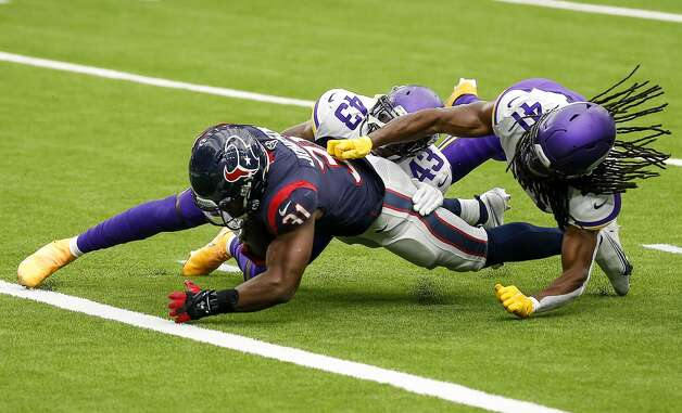 Houston Texans running back David Johnson (31) is tackled inside the 1-yard line by Minnesota Vikings strong safety George Iloka (43) and free safety Anthony Harris (41) during the fourth quarter of an NFL game on Sunday, Oct. 4 2020, at NRG Stadium in Houston. Photo: Jon Shapley/Staff Photographer / © 2020 Houston Chronicle