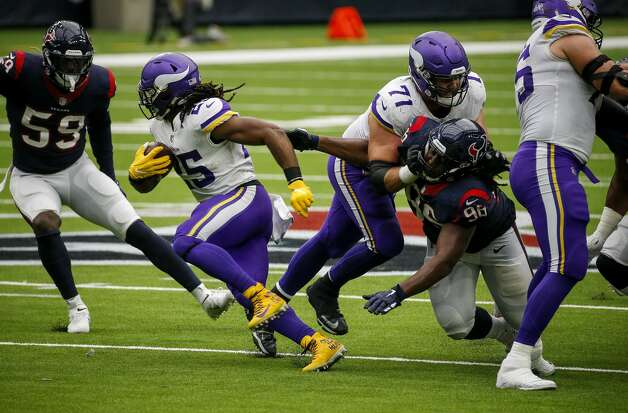 Minnesota Vikings running back Alexander Mattison (25) gets past Houston Texans defensive end P.J. Hall (96) with a block from offensive tackle Riley Reiff (71) during the fourth quarter of an NFL game on Sunday, Oct. 4 2020, at NRG Stadium in Houston. Photo: Jon Shapley/Staff Photographer / © 2020 Houston Chronicle