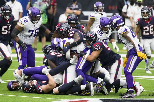 The Houston Texans defense holds up Minnesota Vikings running back Dalvin Cook (33) during the first half of an NFL football game at NRG Stadium on Sunday, Oct. 4, 2020, in Houston. Photo: Brett Coomer/Staff Photographer / © 2020 Houston Chronicle