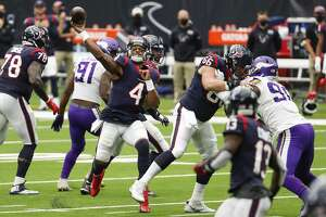 Houston Texans quarterback Deshaun Watson (4) throws a 24-yard touchdown pass to Kenny Stills during the fourth quarter of an NFL football game against the Minnesota Vikings at NRG Stadium on Sunday, Oct. 4, 2020, in Houston.
