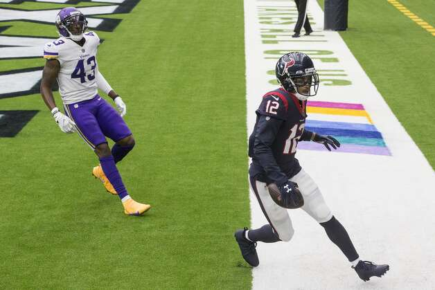 Houston Texans wide receiver Kenny Stills (12) runs past Minnesota Vikings strong safety George Iloka (43) after making a 24-yard touchdown grab during the fourth quarter of an NFL football game at NRG Stadium on Sunday, Oct. 4, 2020, in Houston. Photo: Brett Coomer/Staff Photographer / © 2020 Houston Chronicle