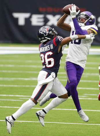 Minnesota Vikings wide receiver Justin Jefferson (18) leaps over Houston Texans cornerback Vernon Hargreaves III (26) to make a first down reception during the third quarter of an NFL football game at NRG Stadium on Sunday, Oct. 4, 2020, in Houston. Photo: Brett Coomer/Staff Photographer / © 2020 Houston Chronicle