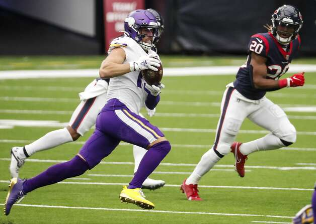 Minnesota Vikings wide receiver Adam Thielen (19) makes a first down catch in front of Houston Texans strong safety Justin Reid (20) during the third quarter of an NFL football game at NRG Stadium on Sunday, Oct. 4, 2020, in Houston. Photo: Brett Coomer/Staff Photographer / © 2020 Houston Chronicle