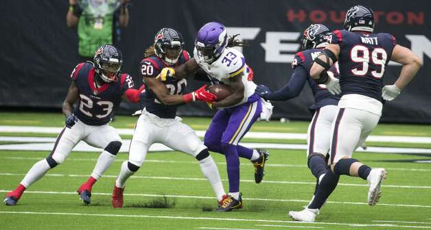Minnesota Vikings running back Dalvin Cook (33) is hit by Houston Texans strong safety Justin Reid (20) as he runs the ball through free safety Eric Murray (23), outside linebacker Whitney Mercilus (59) and defensive end J.J. Watt (99) during the first half of an NFL football game at NRG Stadium on Sunday, Oct. 4, 2020, in Houston. Photo: Brett Coomer/Staff Photographer / © 2020 Houston Chronicle