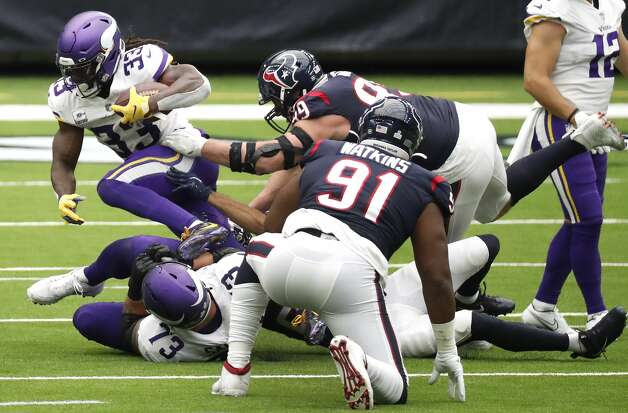 Minnesota Vikings running back Dalvin Cook (33) works to break out of the grasp of Houston Texans defensive end J.J. Watt (99) on a run during the first half of an NFL football game at NRG Stadium on Sunday, Oct. 4, 2020, in Houston. Photo: Brett Coomer/Staff Photographer / © 2020 Houston Chronicle